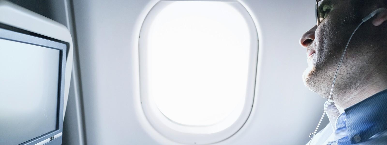 Businessman  using digital tablet  on airplane.